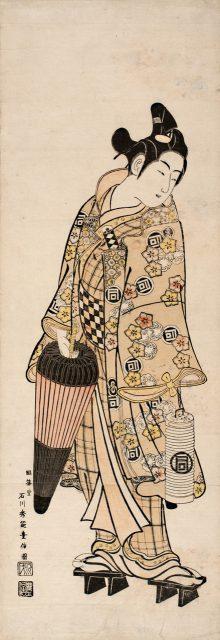 石川豊信《 傘と提灯を持つ佐野川市松》  幅広柱絵判紅絵 寛延期(1748-51)